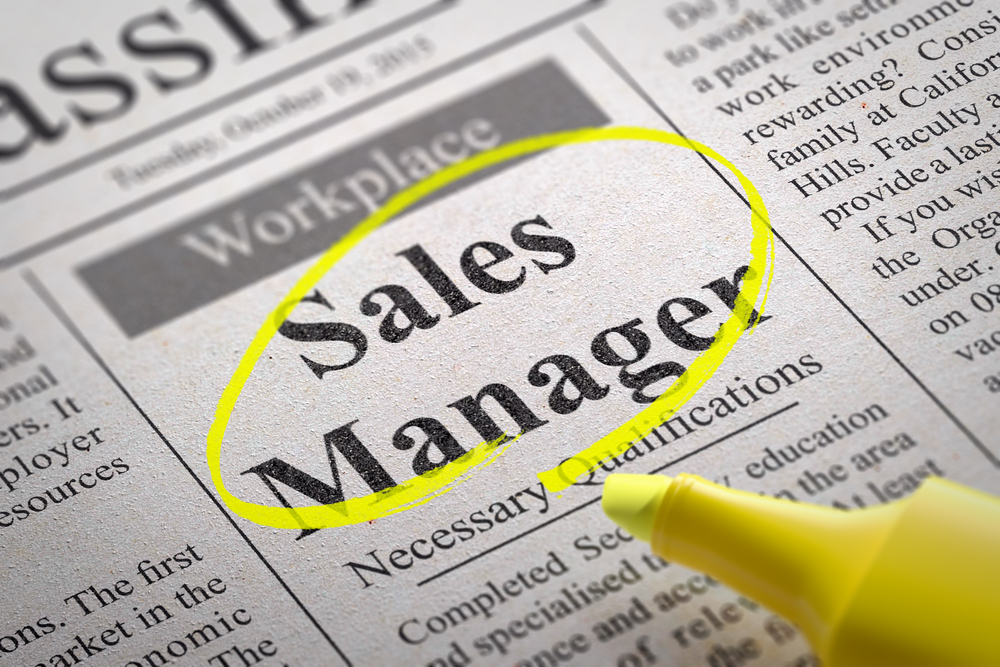 Sales Manager Jobs in Newspaper. Job Seeking Concept.